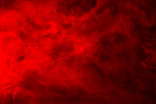 Red smoke on a black background, abstract background