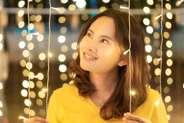 Asian girl smileing with bokeh light in christmas day, selective focus