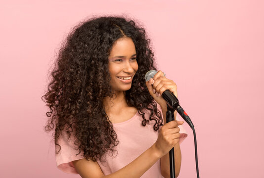 Vivacious young black girl with a microphone