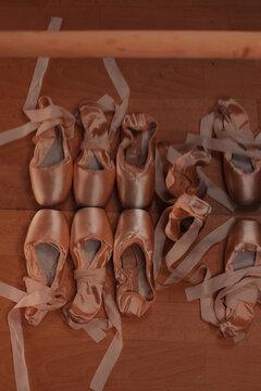 Ballet pointe slippers next to mirror in the dance studio