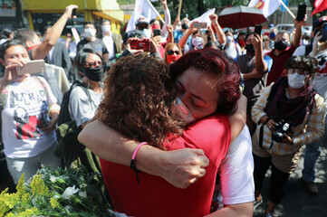 A supporter embraces Mexican labor lawyer Susana Prieto who leads a demonstration with supporters and workers outside an office of the Chihuahua state government in Mexico City
