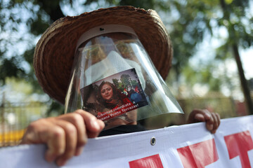 A supporter wears a face shield with an image of Mexican labor lawyer Susana Prieto who leads a demonstration with supporters and workers outside an office of the Chihuahua state government in Mexico City