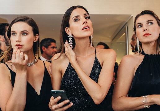 Group of three beautiful woman at a gala night party