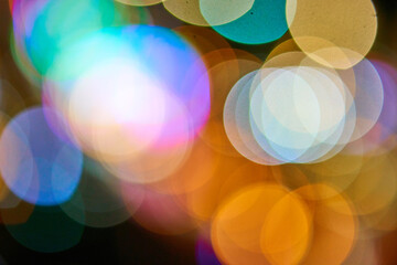 Beautiful bokeh circles from out of focus street lights. Abstract background. Fotomurales