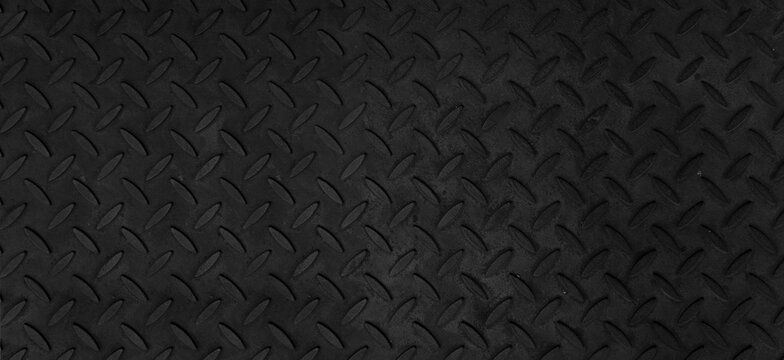 Steel plate pattern Manhole cover of black dark color ,Black dark grey Checker Plate abstract floor metal stanless background stainless pattern surface