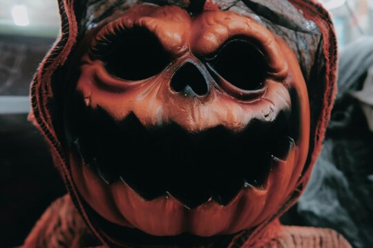 Close-up Of Person Wearing Mask During Halloween