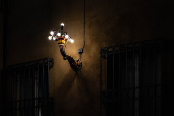 Low Angle View Of Illuminated Lamp Hanging On Wall In Building Fotomurales