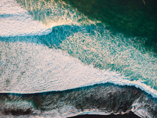 Aerial view of stormy waves in ocean. Biggest wave with foam. Top view.