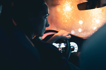 Rear View Of Woman Watching Map While Driving Car