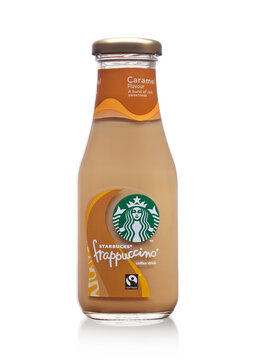 LONDON, UK -DECEMBER 07, 2017: Glass bottle of Starbucks frappuccino coffee drink with caramel on white. Seattle based Starbucks is the largest coffeehouse company in the world.