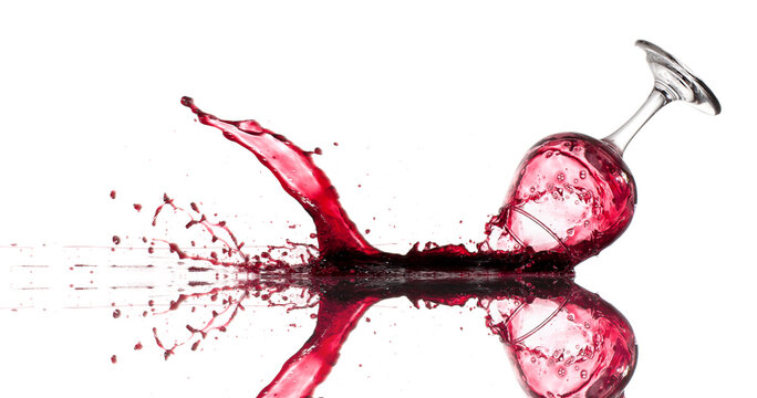 Dropped glass of red wine on a white background