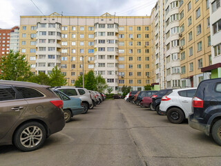 Moscow region, Russia - May, 22, 2020: image of a parking lot near an apartment building