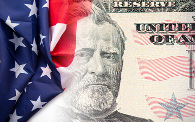 USA American flag and 50 dollars banknotes as background with portrait of diplomat Ulysses S. Grant, concept picture about economy