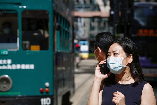 A woman wears a surgical mask following the coronavirus disease (COVID-19) outbreak, in Hong Kong