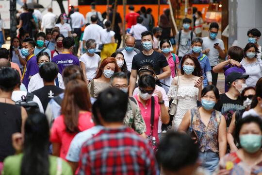 People wear surgical masks following the coronavirus disease (COVID-19) outbreak in Hong Kong