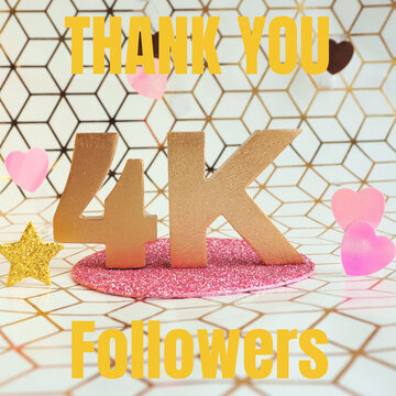 """Lettering in gold volumetric letters """"Thank you 4K followers"""" and pink plastic hearts on a white and gold geometric background.."""
