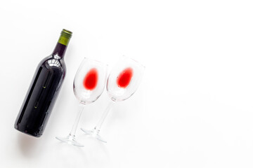 Fototapete - Wine bottle and glasses on white background from above copy space