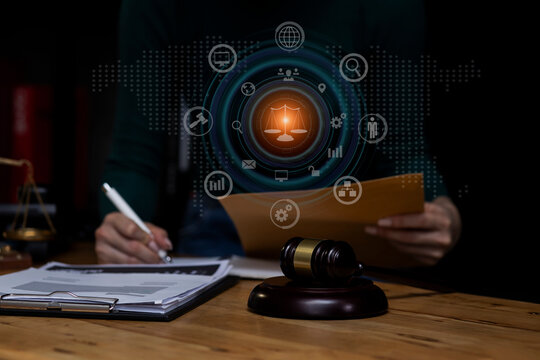 Concepts of Law and Legal services. lawyer business  working on digital tablet and law interface icons.