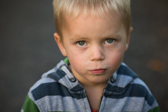 Little boy angry with somebody, sad boy portrait, topview