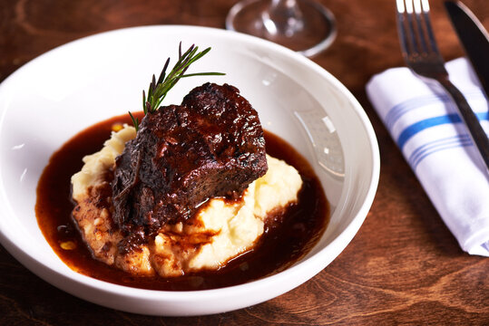 Braised Short Ribs and Mashed Potatoes in White Dish