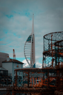 the spinnaker tower in portsmouth framed by fishing pots