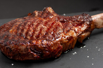 Deurstickers Steakhouse seared tomahawk steak done rare