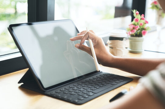 graphic designer using stylus pen on tablet