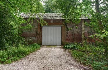 Old garage door in a abandoned building in a rural area