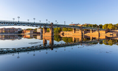 Beautiful reflection of the Saint Pierre bridge in the River Garonne, Toulouse