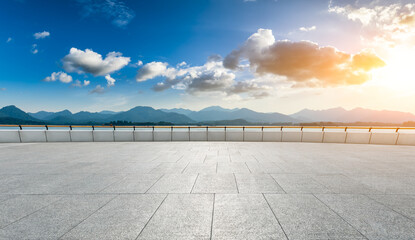 Empty square floor and mountain landscape in hangzhou at sunset.