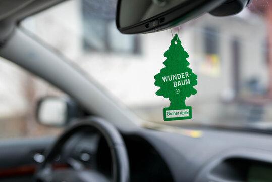 Miercurea Ciuc, Romania- 22 December 2018: Hanging Green Apple Wunder Baum air freshener on car interior.