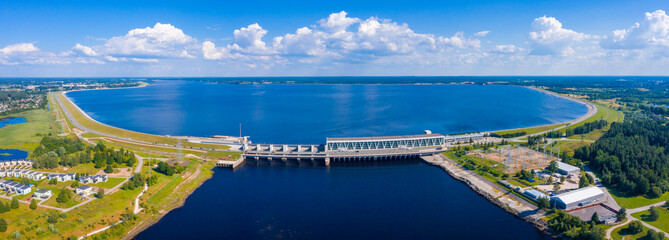 Aerial view of the huge dam in Latvia near city of Salaspils and Riga. A huge reservoir of water and river Daugava.