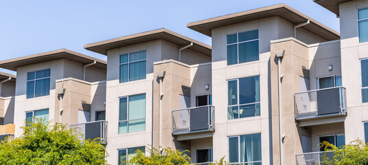 Exterior view of modern apartment building offering luxury rental units in Silicon Valley; Santa Clara, San Francisco bay area, California
