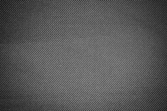 Dark gray cotton fabric with cells pattern texture background.