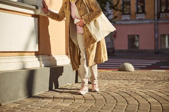 Elderly woman feeling bad in the street of city