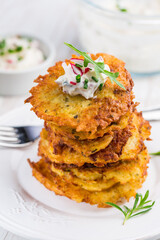 Fried potato pancake with dip of radishes cream cheese and chives