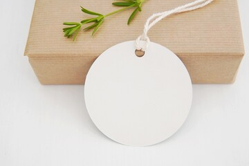 Round empty gift tag mock up, wedding favor, product tag mockup, blank paper label with string on gift box.
