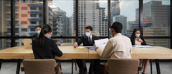 new normal practise businesspeople wear mask and keep social distance