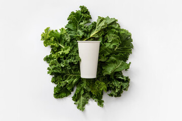white cup on healthy kale leaveswhite cup on healthy kale leaves