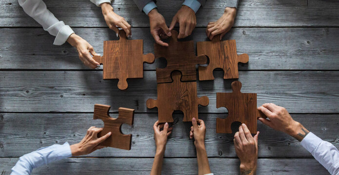 Business people and puzzle pieces