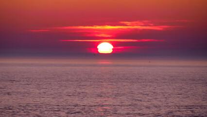Orange, pink, purple, red sunset over the sea