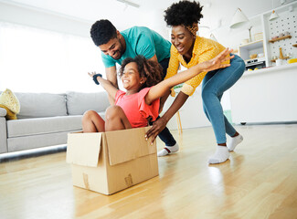 child family father fun mother happy girl happiness daughter box together relocation moving cardboard box