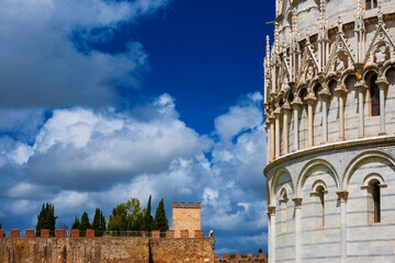 Pisa famous medieval monuments, baptistery and ancient city walls, now open to the public