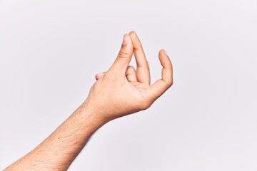 Close up of hand of young caucasian man over isolated background snapping fingers for success, easy...