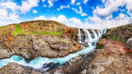 Wall Mural - Majestic Kolufossar waterfall at summer sunny day.