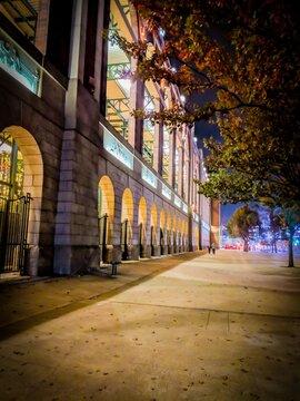 City sidewalk at night in Arlington Texas