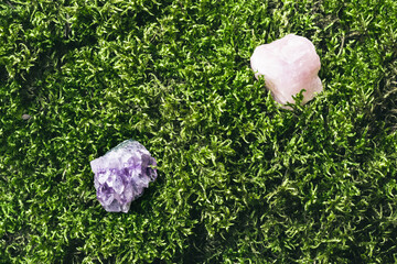 Crystal minerals stones on beautiful moss background. Magic stones for rituals, meditation and spiritual practices