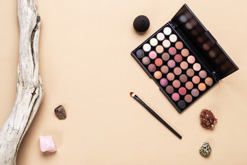 Eye shadow palette, makeup brush and sponge. Minimal beauty cosmetics layout