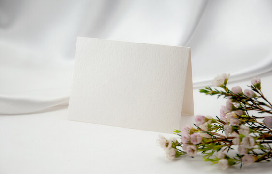 Mockup blank card, for Name place, Folded, greeting, invitation with wax flower on white background.
