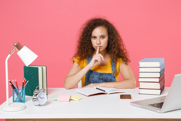 Secret african american girl employee in office isolated on pink background. Achievement business career. Education in school university college concept. Say hush be quiet finger on lips shhh gesture.